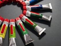 Många mångfärgade rör med vattenfärger fotografering för bildbyråer