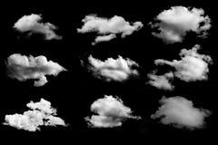 Många moln som isoleras på svart bakgrund Arkivbild