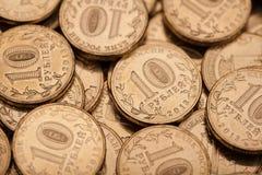 Många myntbakgrund Arkivfoto