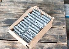 Många nya fyrkantiga järndetaljer - mellanrum Metallteknik Royaltyfri Foto