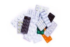 Många olika färgrika läkarbehandling och preventivpillerar från över Arkivfoto