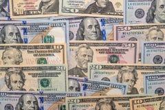 Många olika oss dollar Arkivbild