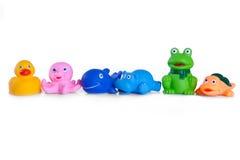 Många olika toys av rubber djur Arkivfoton