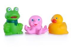 Många olika toys av rubber djur Arkivfoto
