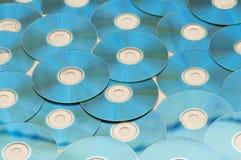 Många ordnad cds Arkivfoto