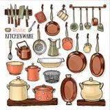 Många pannor som hänger i ett retro kök Arkivfoton