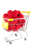 Många röda hjärtor i shoppingvagn Royaltyfri Fotografi