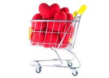 Många röda hjärtor i shoppingvagnssida beskådar Arkivfoton
