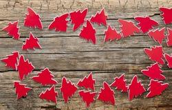 Många röda julträd som bakgrund Royaltyfri Bild