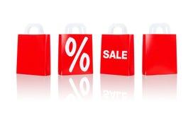 Många röda shoppingpåsar med försäljning och procentsats Fotografering för Bildbyråer