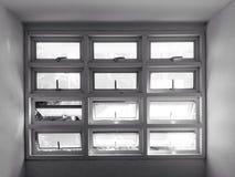 Många rektanglar göras av små glass fönster Royaltyfria Bilder