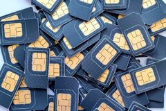 Många SIM-kort är i en hög Fotografering för Bildbyråer