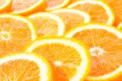 många skivade apelsiner Arkivfoto