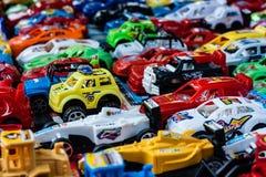 Många små leksakbilar Arkivfoto