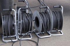Många spolar med elektriska trådar arkivfoto