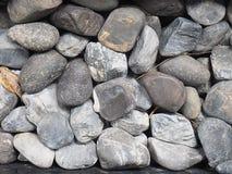 Många stenar på jordningen Arkivbild