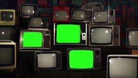 Många tv:ar med gröna skärmar stock video