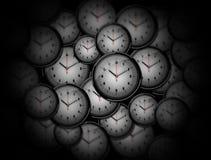 Många utdelade klockor på måfå Royaltyfria Foton