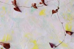 Mångfärgad abstrakt bakgrund med den torra växtfilialen Utrymme för en text Arkivfoton