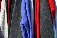 mångfärgad clothing fall arkivfoto