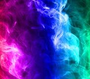mångfärgad rök arkivfoto