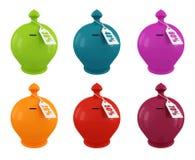 mångfärgad set för moneybox Arkivfoto