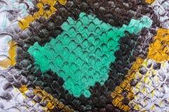 Mångfärgad textur för pytonorm för fauxläderorm för bakgrund close upp arkivbilder