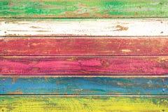 Mångfärgad wood bakgrund - tappningtapetmodell royaltyfri fotografi