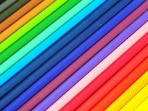 mångfärgade blyertspennor för bakgrund Arkivfoton