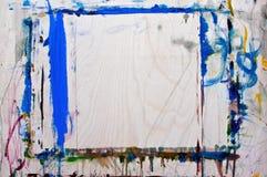 Mångfärgade och kaotiska borsteslaglängder med olja på kanfas Bakgrund Arkivbild