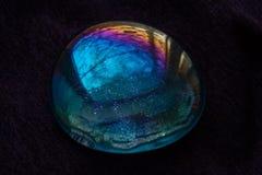 Mångfärgat exponeringsglas på purpurfärgad bakgrund Royaltyfri Fotografi