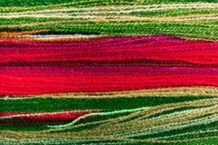 mångfärgat garn för bakgrund royaltyfria foton