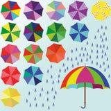mångfärgat paraply arkivbilder