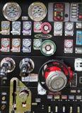 Mått på sidan av en brandmotor Arkivbild