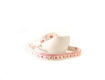 Måttband i koppen Royaltyfri Foto