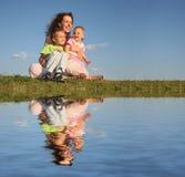 Mère avec des enfants Photo stock