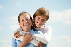 Mère avec le descendant de l'adolescence Photographie stock
