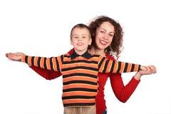 Mère avec le fils sur le blanc Photo libre de droits