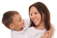 Mère avec son enfant sur un blanc Photographie stock