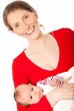 Mère d'une cinquantaine d'années de sourire avec un beau bébé Photo stock