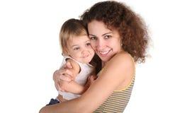 Mère de sourire avec la chéri photo libre de droits