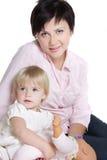 Mère et descendant au-dessus de blanc Image libre de droits