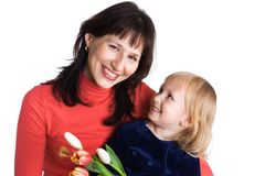 Mère et descendant avec des tulipes Photographie stock libre de droits