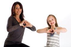 Mère et descendant avec le grand coeur Photographie stock libre de droits