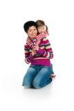 Mère et descendant sur le blanc Image stock