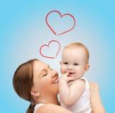 Mère heureuse avec le bébé adorable Photo libre de droits