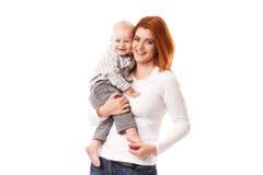 Mère heureuse avec le bébé d'isolement Image libre de droits