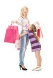 Mère heureuse et petite fille avec des paniers image libre de droits