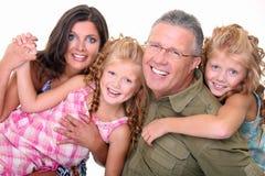 Mère, père et gosses jumeaux mignons Photographie stock libre de droits