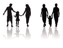 Mère, père, silhouette d'enfant Photos libres de droits